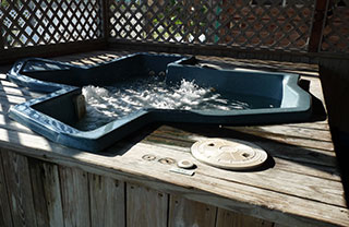 Texas-shaped hot tub big enough for 6 to fit snugly.