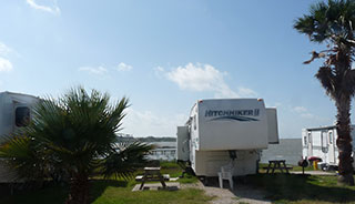Some sites include Bay-front views, with a view of the Corpus Christi skyline in the distance.