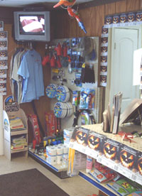 The convenience store also includes brochures on local attractions, t-shirts, and other items