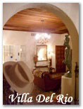 Villa Del Rio B&B, surrounded by majestic palm trees, pecans, and border charm