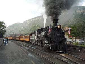The Durango & Silverton Narrow Gauge blows off some steam and gets ready for another run