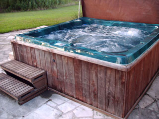The inviting hot tub is the pefect way to relax after a long day of travel or sightseeing