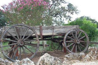 A rustic wagon on the grounds of the Bear Creek Retreat