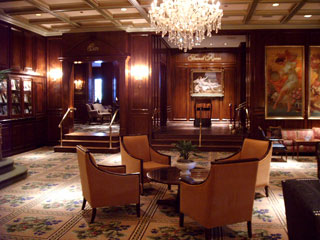 The stately lobby area near the entrance to the five-diamond rated French Room restaurant in the Adolphus in Dallas. To the left are displayed letters and photographs of some of the more famous who have stayed here