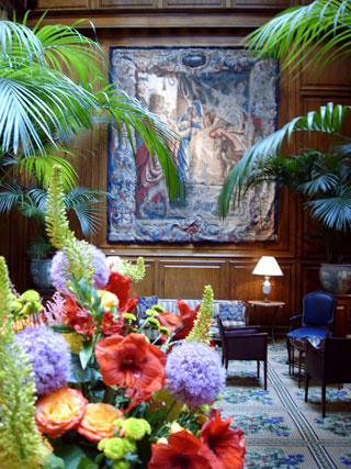 A large display of fresh flowers are a centerpiece, with rare Belgian tapestries along the walls, which date to the 16th century at the Adolphus Hotel