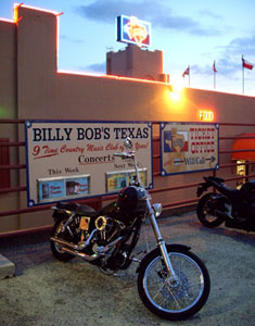 Park your horses outside and enjoy the fun at Billy Bob's Texas, the largest honky tonk in the world