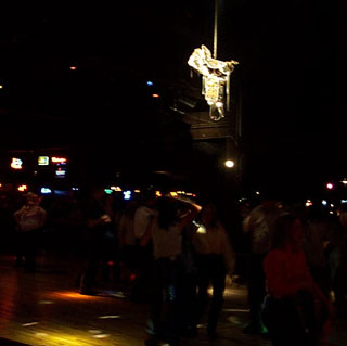 Dancing under the golden saddle at Billy Bob's Texas in Fort Worth