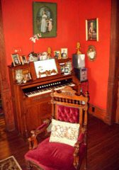 The Parlor Room is appointed with numerous antiques, paintings, and photos of the early history of the island