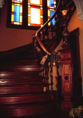 the dramatic staircase of the Coppersmith Inn