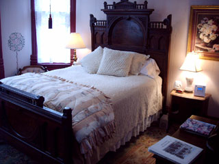 heather's Rose Room, with distinctive high-back bed headboard