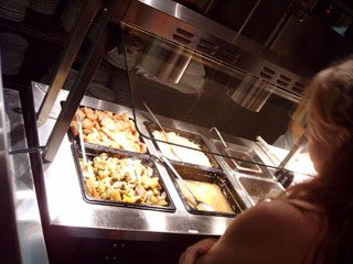 Try the delicious buffet at Louie's Backyard