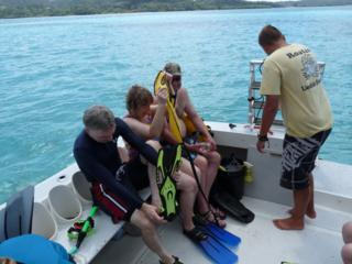 Guests get ready to snorkel and explore the coral reef