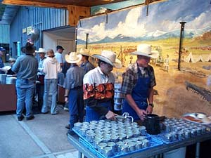 Bar D Chuckwagon workers serving up the lemonade in the serving line