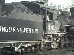 The #482 locomotive being readied by the conductor for another run, which dates to the early 1920s.