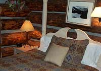 The main bedroom within the two story log cabin.