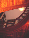 The large staircase at Grace Manor. Note the rich wood grain and detailed workmanship