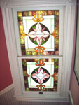 The house includes several charming stain glass windows, which dramatically show light through in the late afternoons