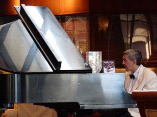 Tony Lara at the piano at the Omni San Antonio Hotel