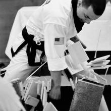 US Tae Kwon Do College Master breaking stack of boards.