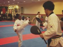US Tae Kwon Do College students practicing a round house kick