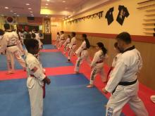 US Tae Kwon Do College students practice one step sparring.
